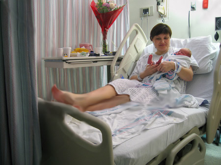 stock-photo-newborn-baby-with-mother-in-hospital-8530588